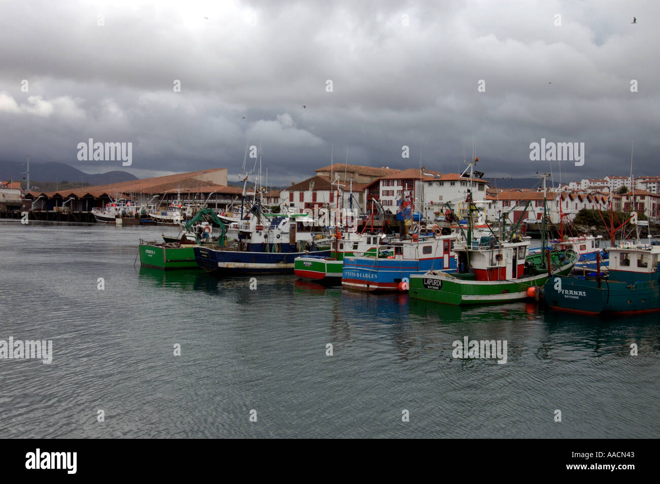 fishing port at a rainy day in St Jean de Luz Pyrenees Atlantiques France - Stock Image