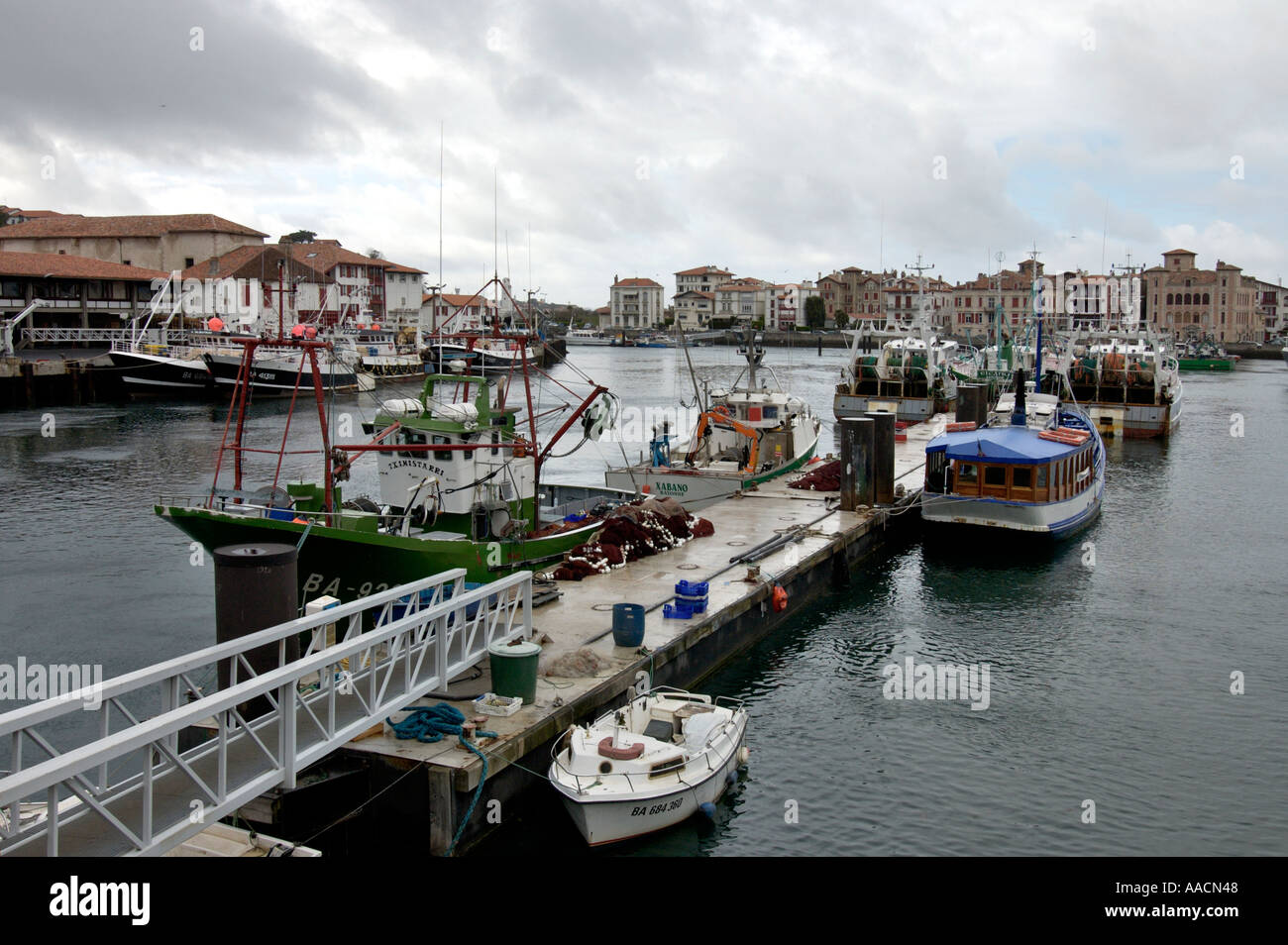 fishing port at a rainy day in St Jean de Luz and in Ciboure Pyrenees Atlantiques France - Stock Image