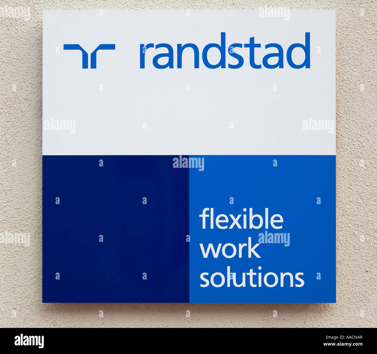 A sign for temporary employment agency Randstad - Stock Image