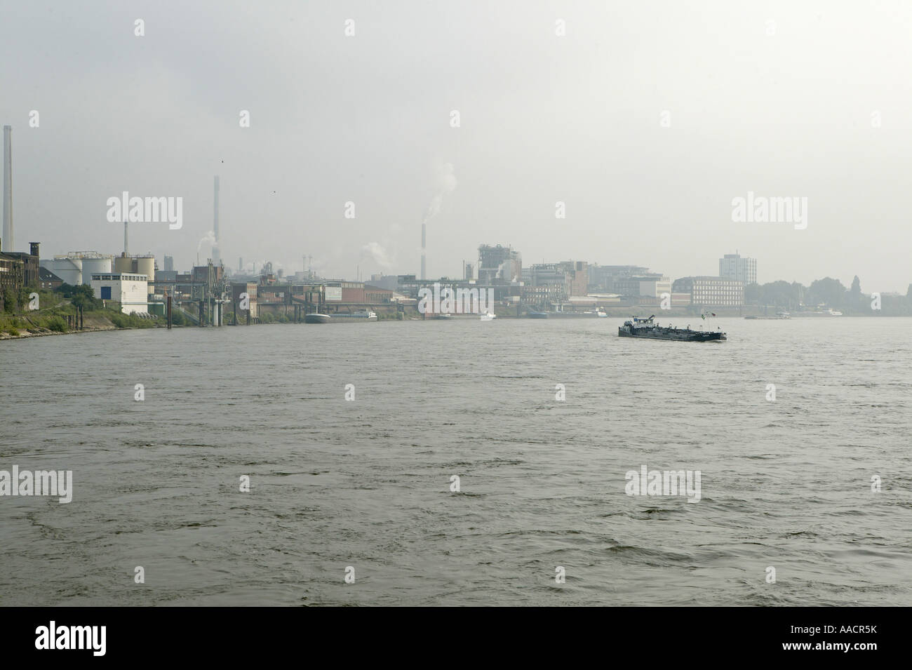 Rhine with industrial plants near Krefeld-Uerdingen, Krefeld, North Rhine-Westphalia, Germany Stock Photo