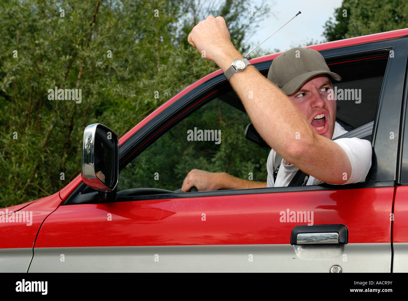 Cardriver makes angry gestures - Germany, Europe - Stock Image