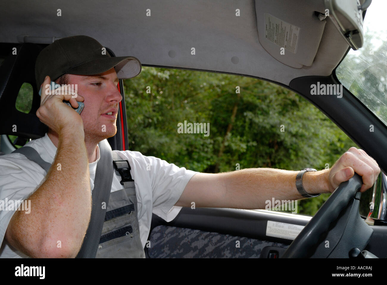 Cardriver with telephone - Germany, Europe Stock Photo