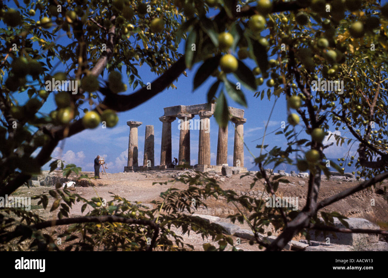 Beautiful ancient Greek temple on a hillside in Crete seen from an olive grove - Stock Image