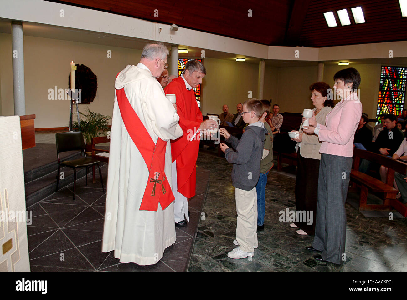 Presentation of the gifts during the first mass of a newly