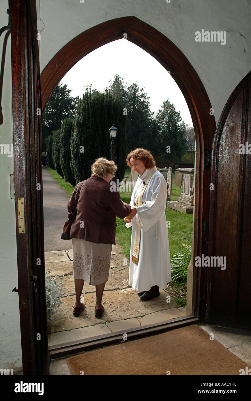 Woman Priest Greeting The Congregation After The Anglican Service In
