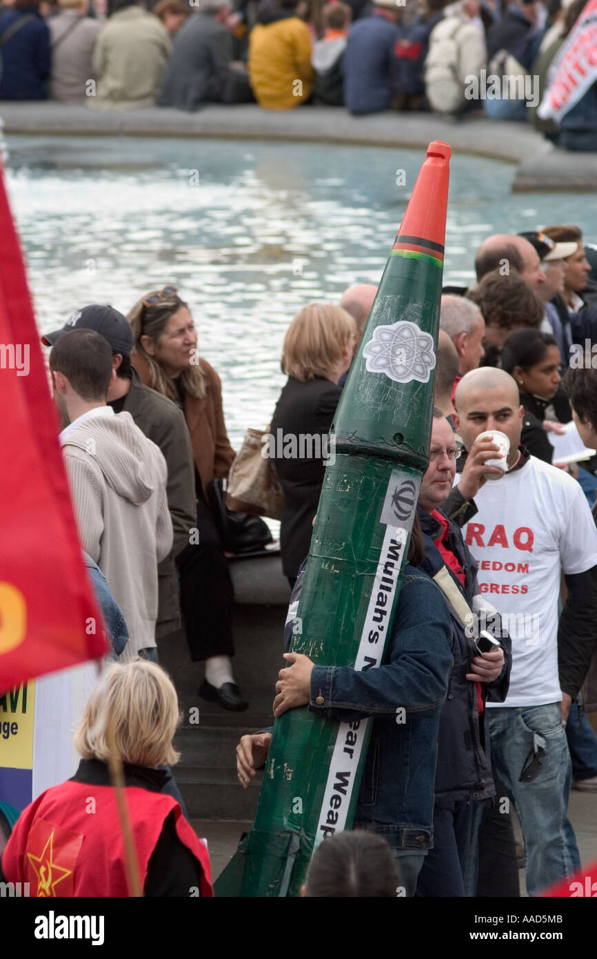 Protestor with fake nuclear missile during May Day demonstration. Trafalgar Square, London, England - Stock Image