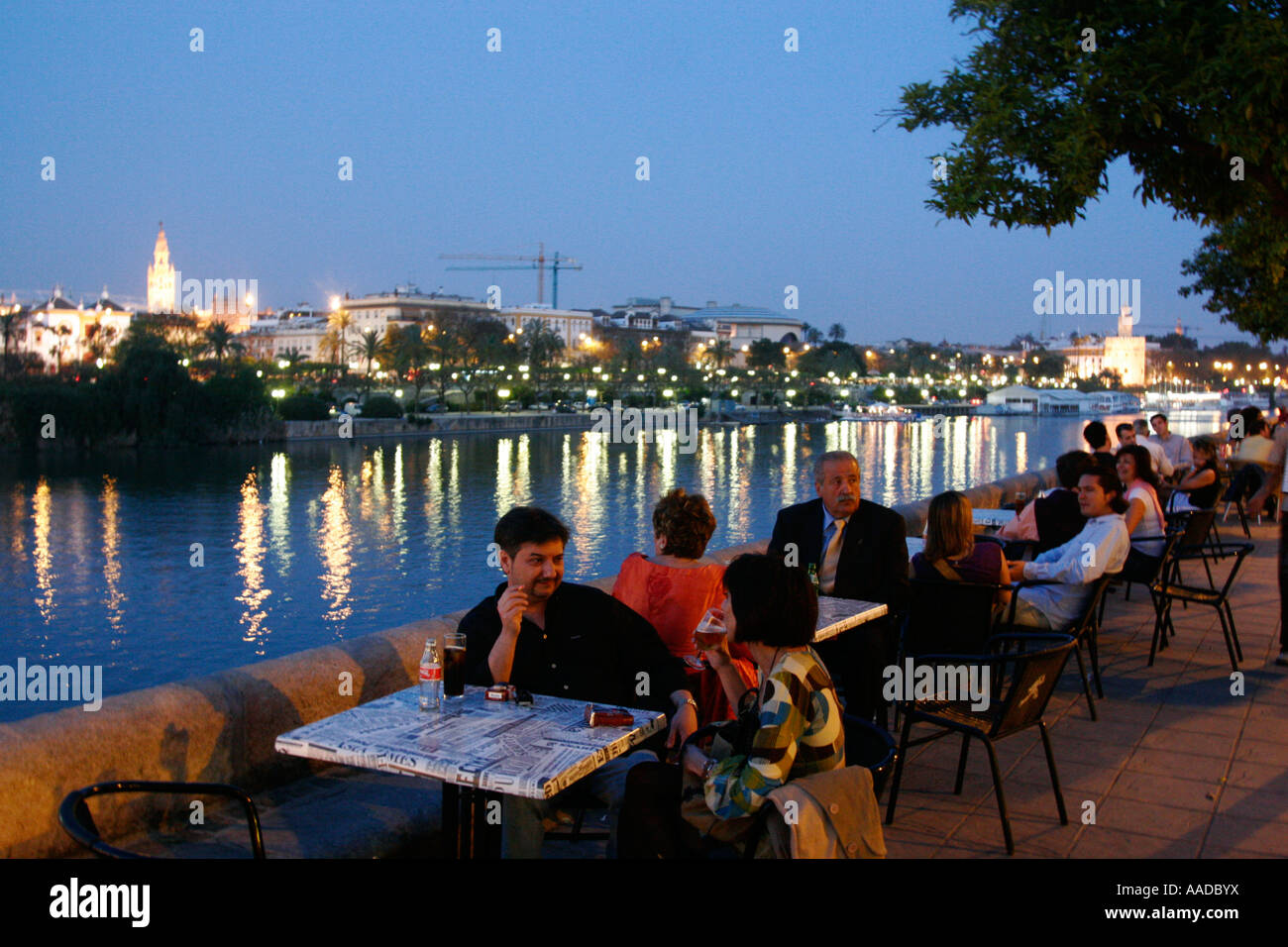 People Sitting At Restaurant By The Guadalquivir River