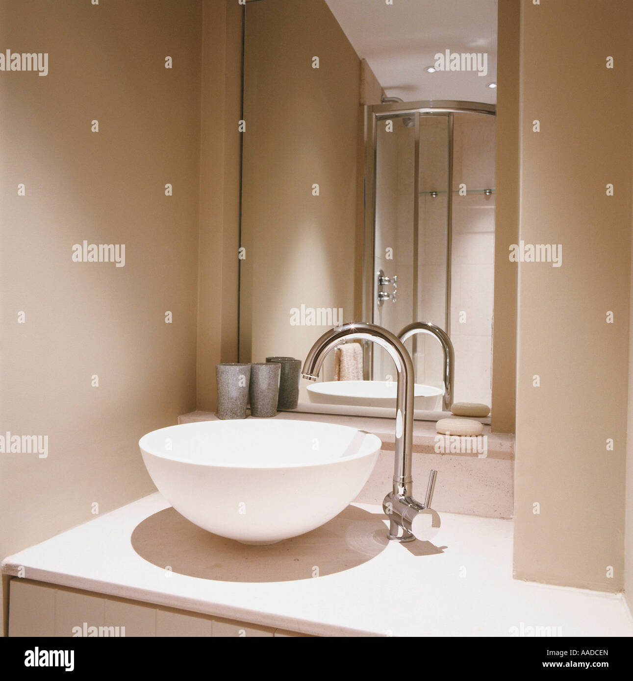 Neutral wash basin and tap with mirror - Stock Image