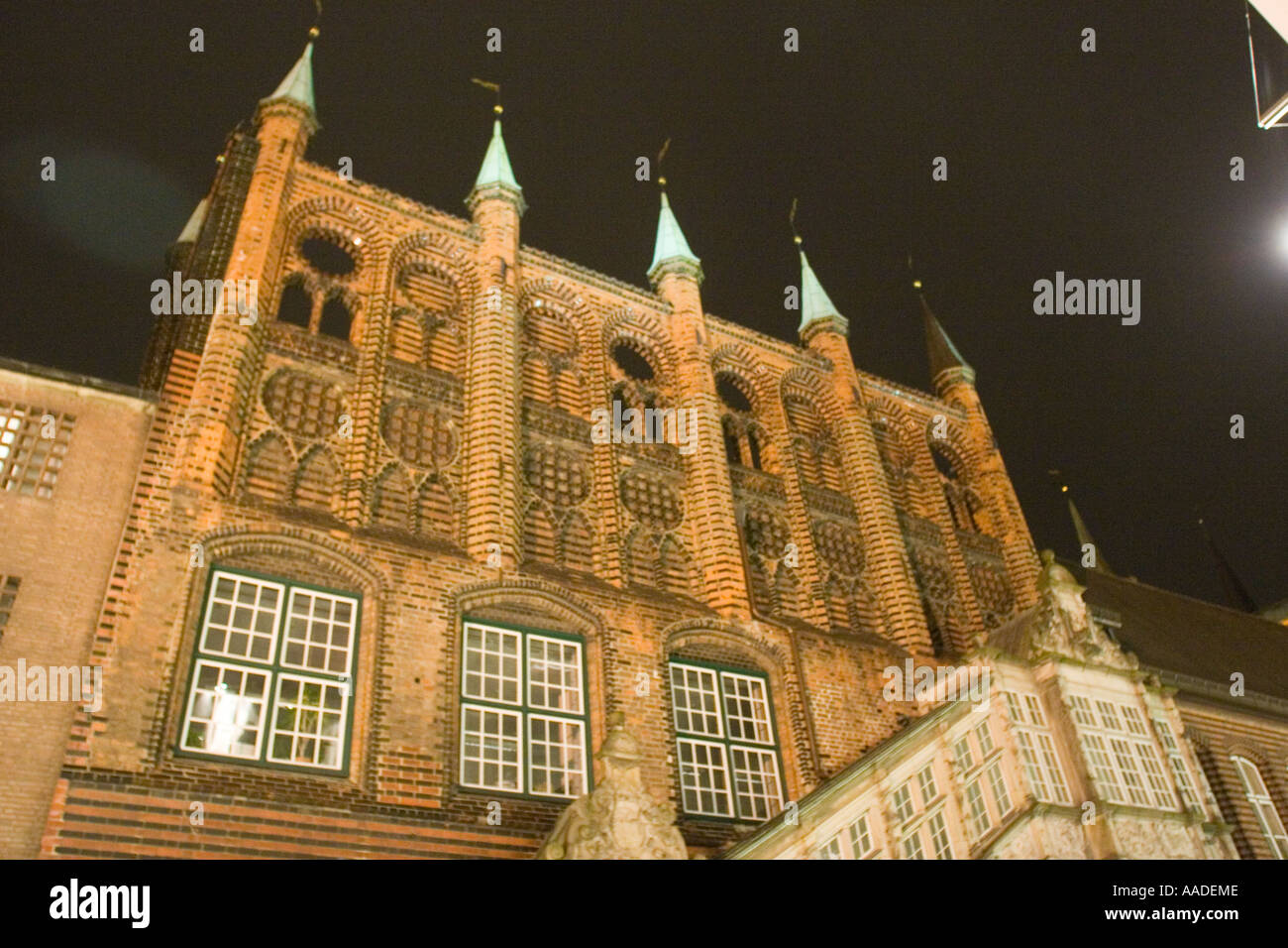 Town hall Rathaus front at night in Lubeck - market  town, Northern Germany - Stock Image