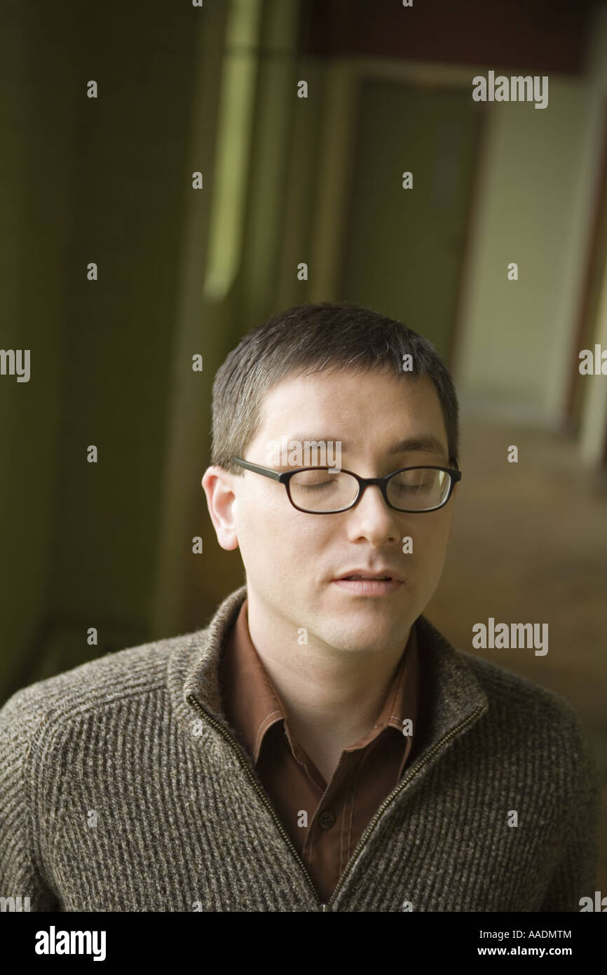 Man with Eyes Wide Shut - Stock Image