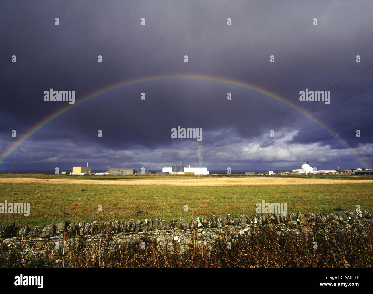 dh  DOUNREAY CAITHNESS Nuclear atomic reactor electricity power station rainbow black cloud - Stock Image
