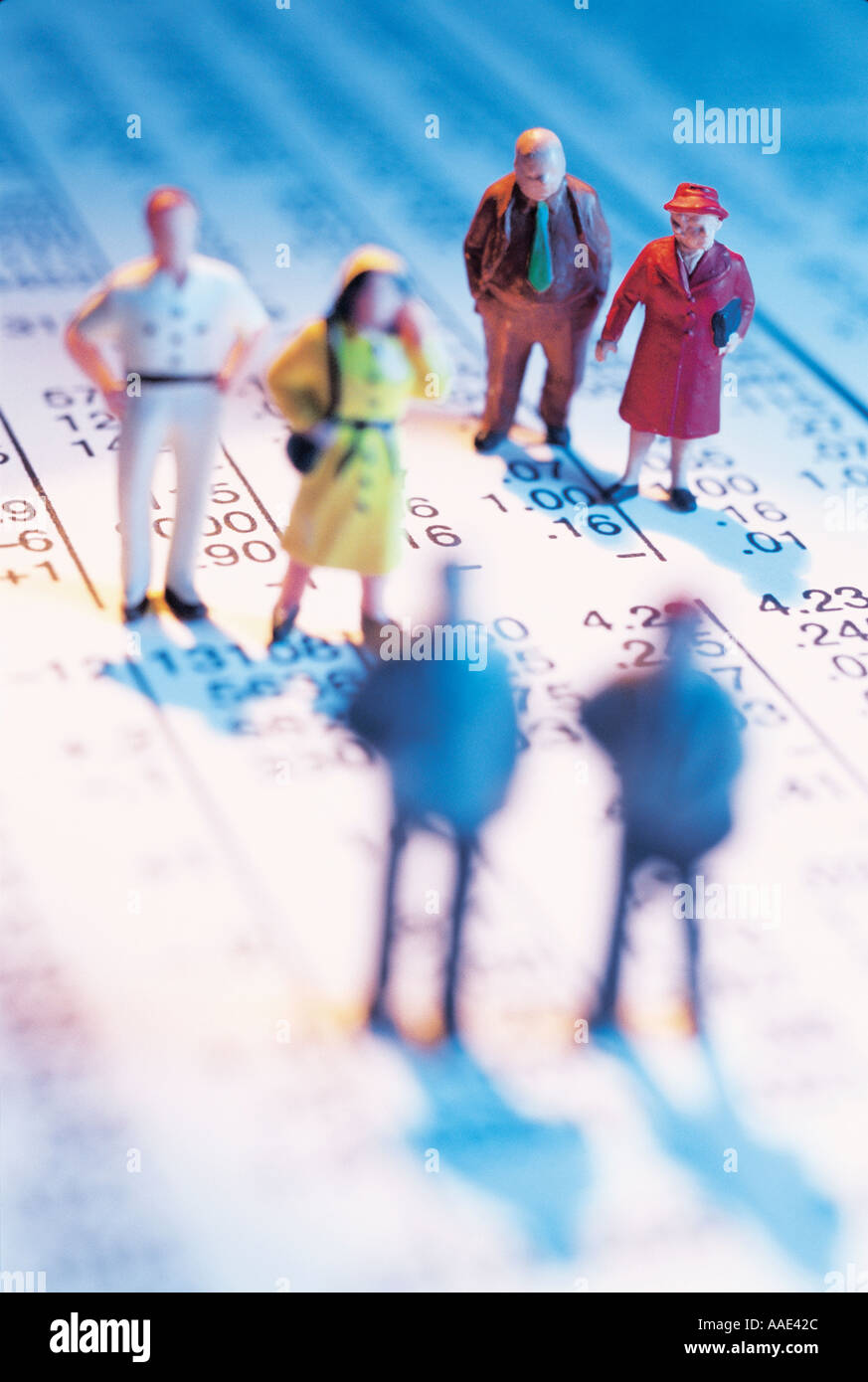 Minature Figures on Stock Listings - Stock Image