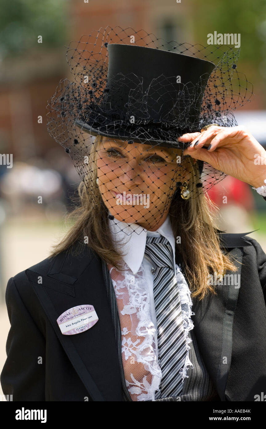 Young woman wearing a tuxedo on Ladies day at Royal Ascot - Stock Image