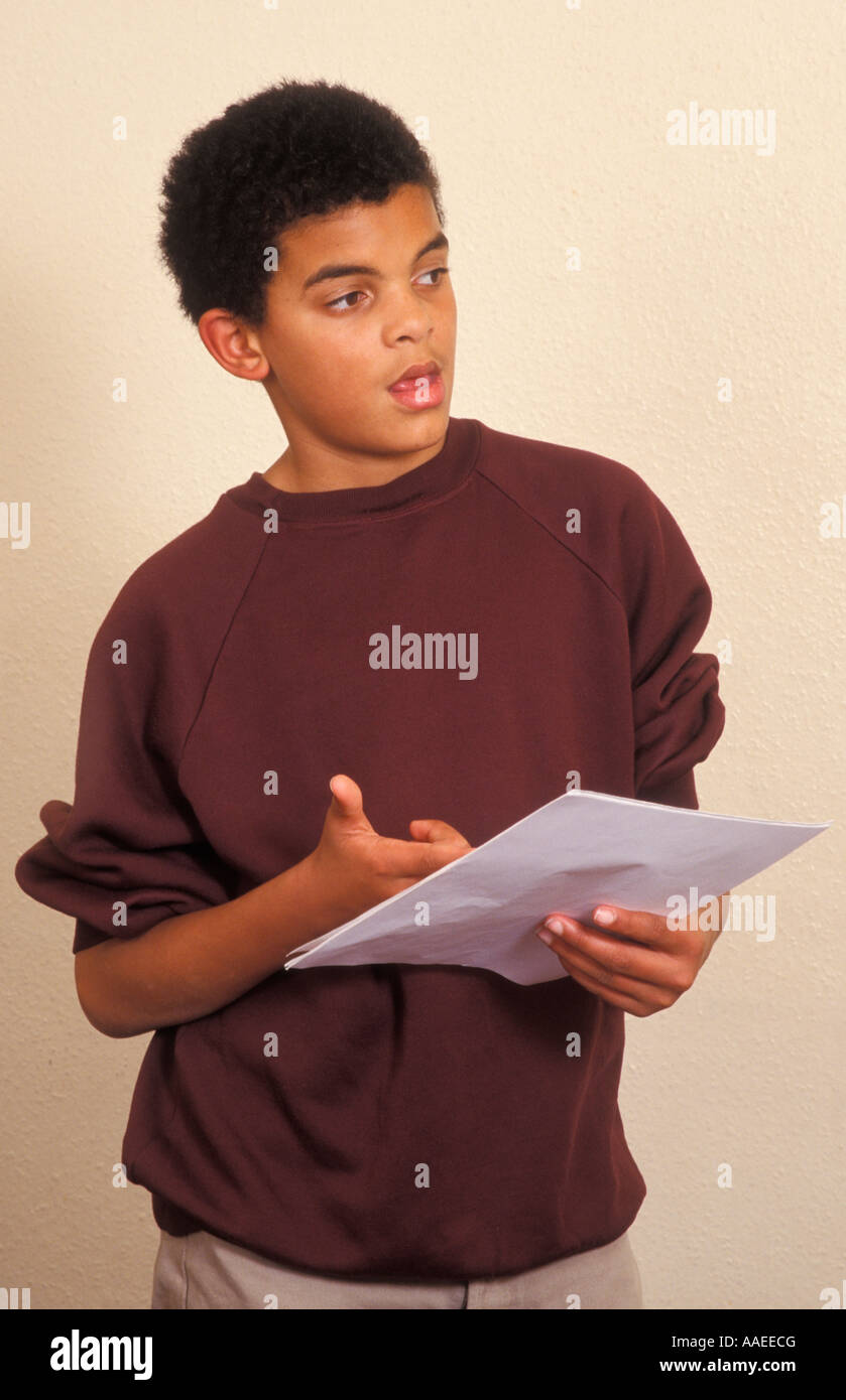 young teenage mixed race boy reading from script