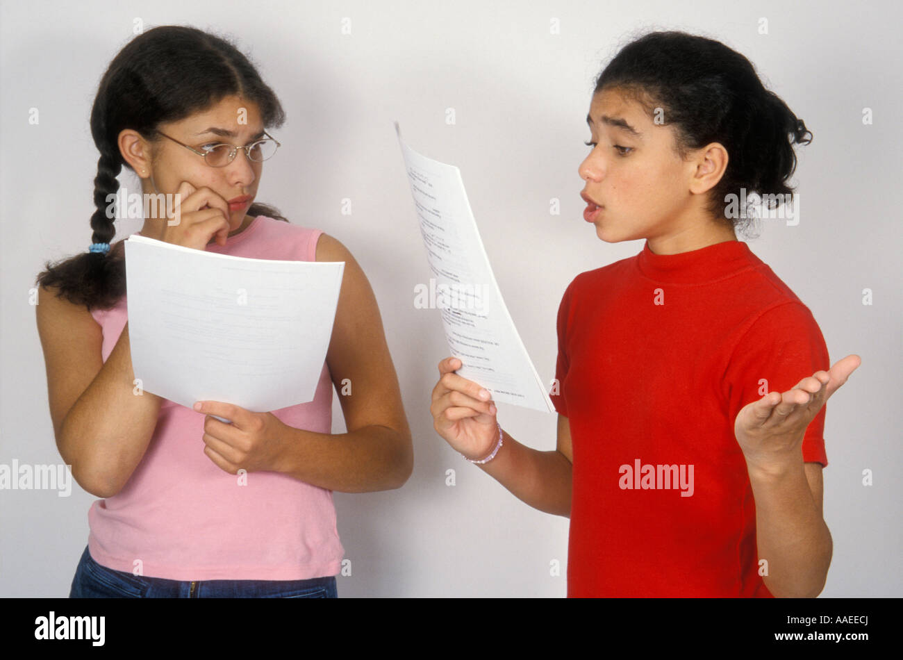 2 young girls aged 12 - 14 reading and performing from script - Stock Image