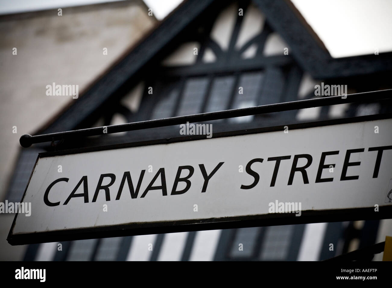 Carnaby Street road sign with Libertys in the background - Stock Image