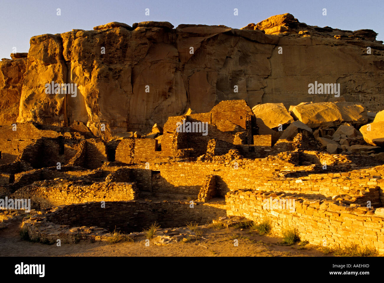 Pueblo Bonito glows in afternoon sun in Chaco Culture National Historical Park, Chaco Canyon, New Mexico USA - Stock Image