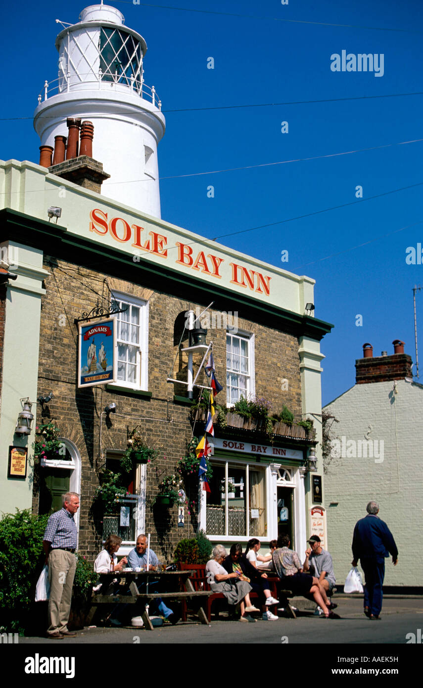 The Sole bay Inn Pub with Lighthouse in the back Southwold Suffolk England - Stock Image