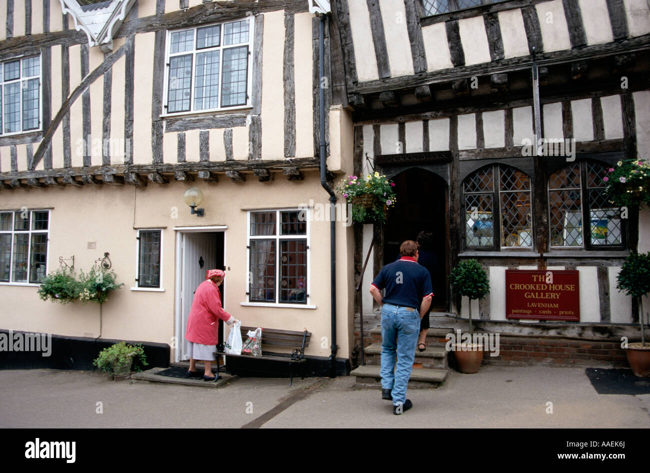 People in front of their half timbered houses Cavendish Suffolk England - Stock Image