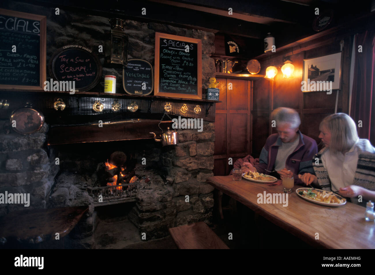 Couple eating The Warren House Inn Dartmoor Devon England United Kingdom - Stock Image