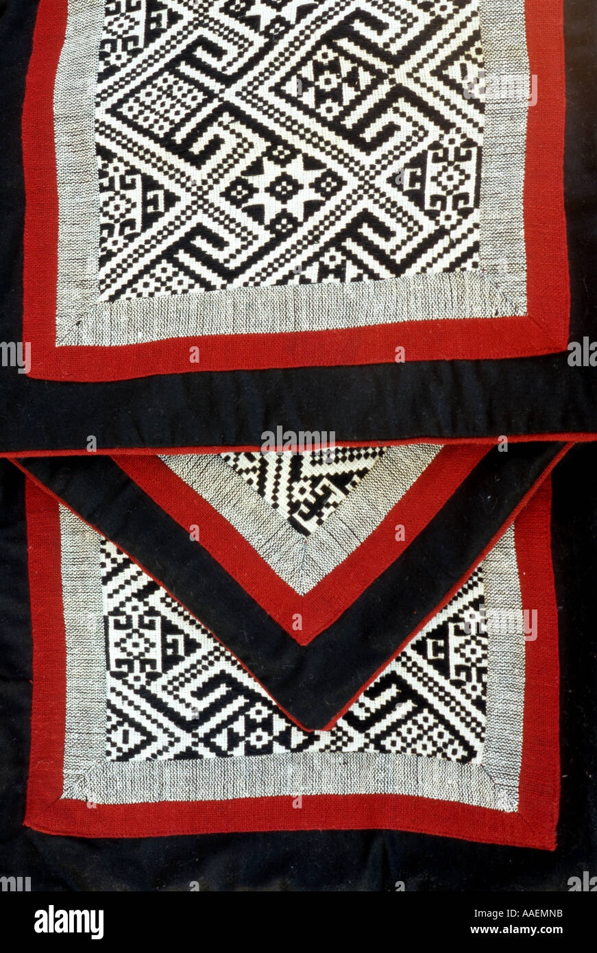 Red, black and white woven fabric on three cushion covers from NW Viet Nam Stock Photo