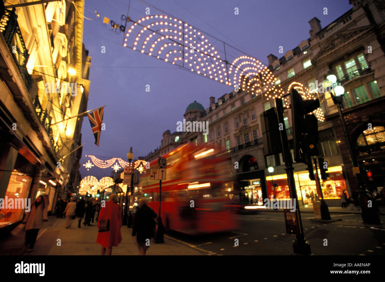 London Buses at night in Oxford StreetIlluminated Regent Street at Christmas time London England - Stock Image