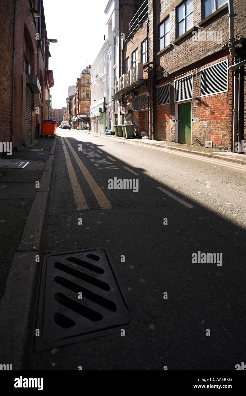 Backstreet, Spear Street, looking towards Hilton St and Stevenson Square, Manchester, UK - Stock Image
