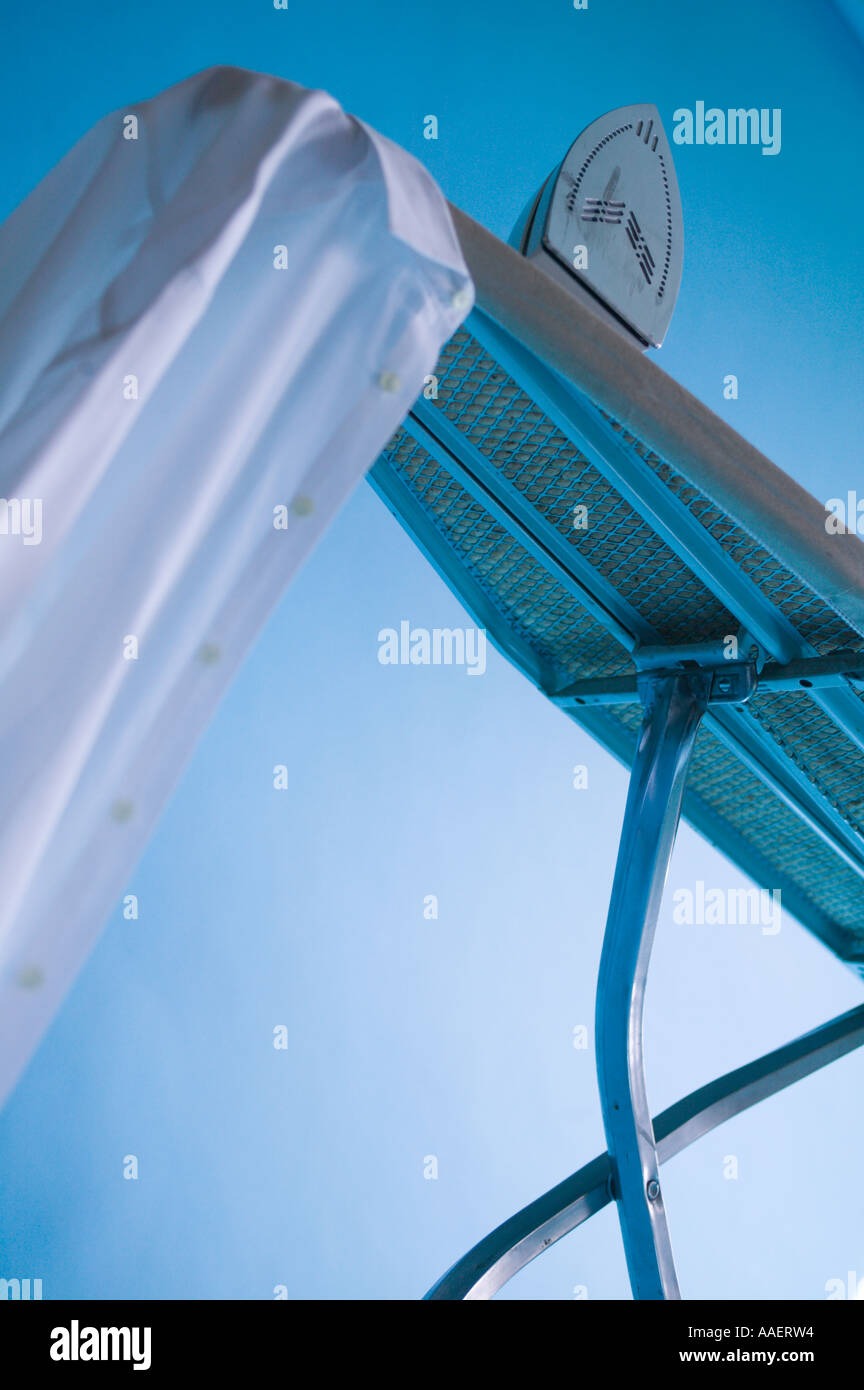 Iron and Ironing Board - Stock Image