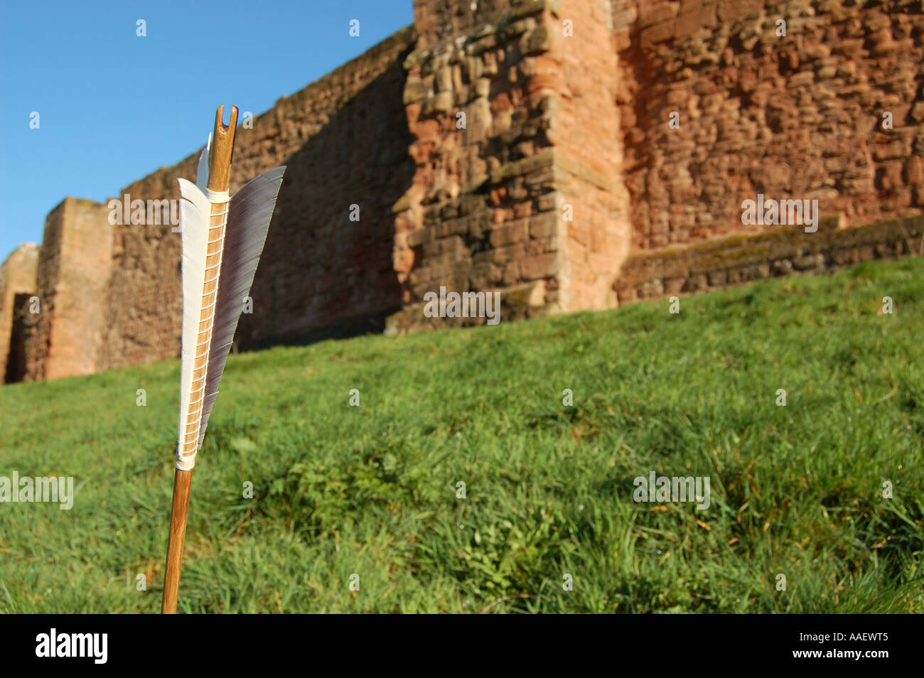 Medieval arrow by castle wall - Stock Image