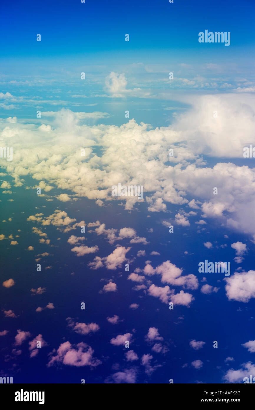 Cloud formations above Atlantic Ocean from window of jet passenger aircraft airplane aeroplane double polarised Stock Photo