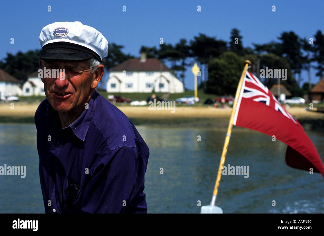 John White operating the Bawdsey to Felixstowe ferryboat on the river Deben, Suffolk, UK - Stock Image