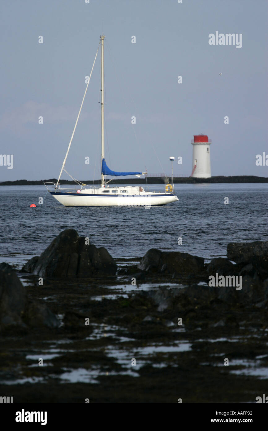 solar powered lighthouse at Angus Rock and yacht Strangford Lough County Down Northern Ireland - Stock Image