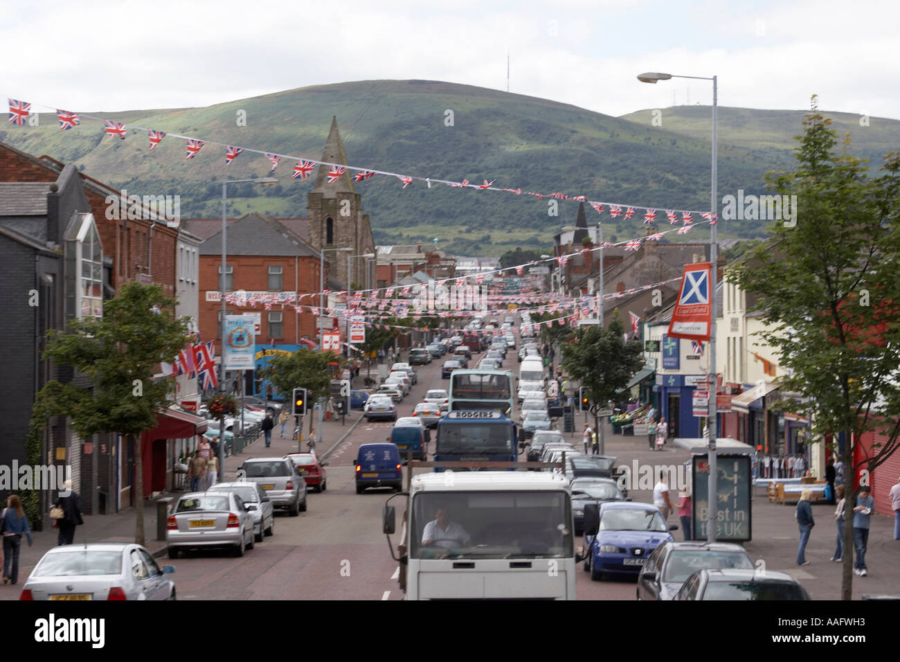 Loyalist Union Jack flags logos murals signs and graffiti on Shankill Road in City of Belfast Northern Ireland UK - Stock Image