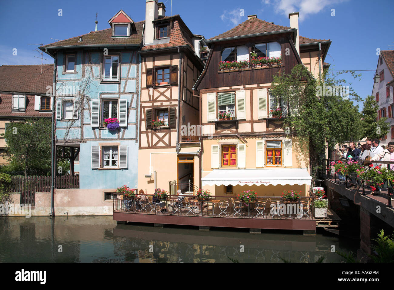 Open air cafe on platform over the river in the town of Colmar, Alsace, France. Stock Photo