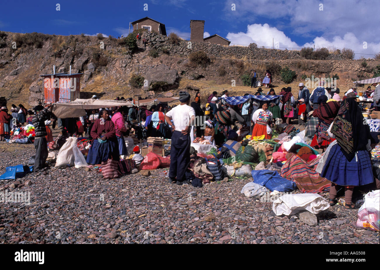 Amantani island Shopping at the Wednesday market buying produce from traders from Puno Lake Titicaca Peru - Stock Image