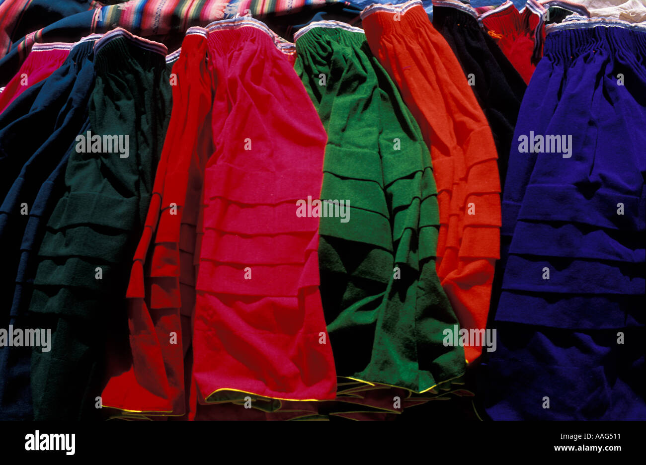 Selection of bright skirts in the style popular on Taquile Amantani islands Amantani Wednesday market Lake Titicaca Peru - Stock Image