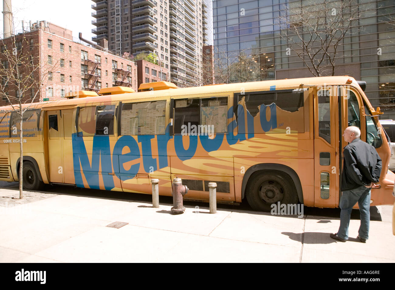 People wait to enter a Metrocard bus in a street in New York City USA April 2006 Stock Photo