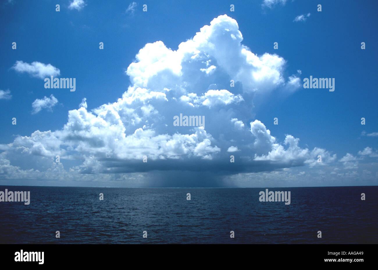 Cumulonimbus clouds with rain precipitation falling on the sea Southern Ari Atoll Alifu Maldives - Stock Image