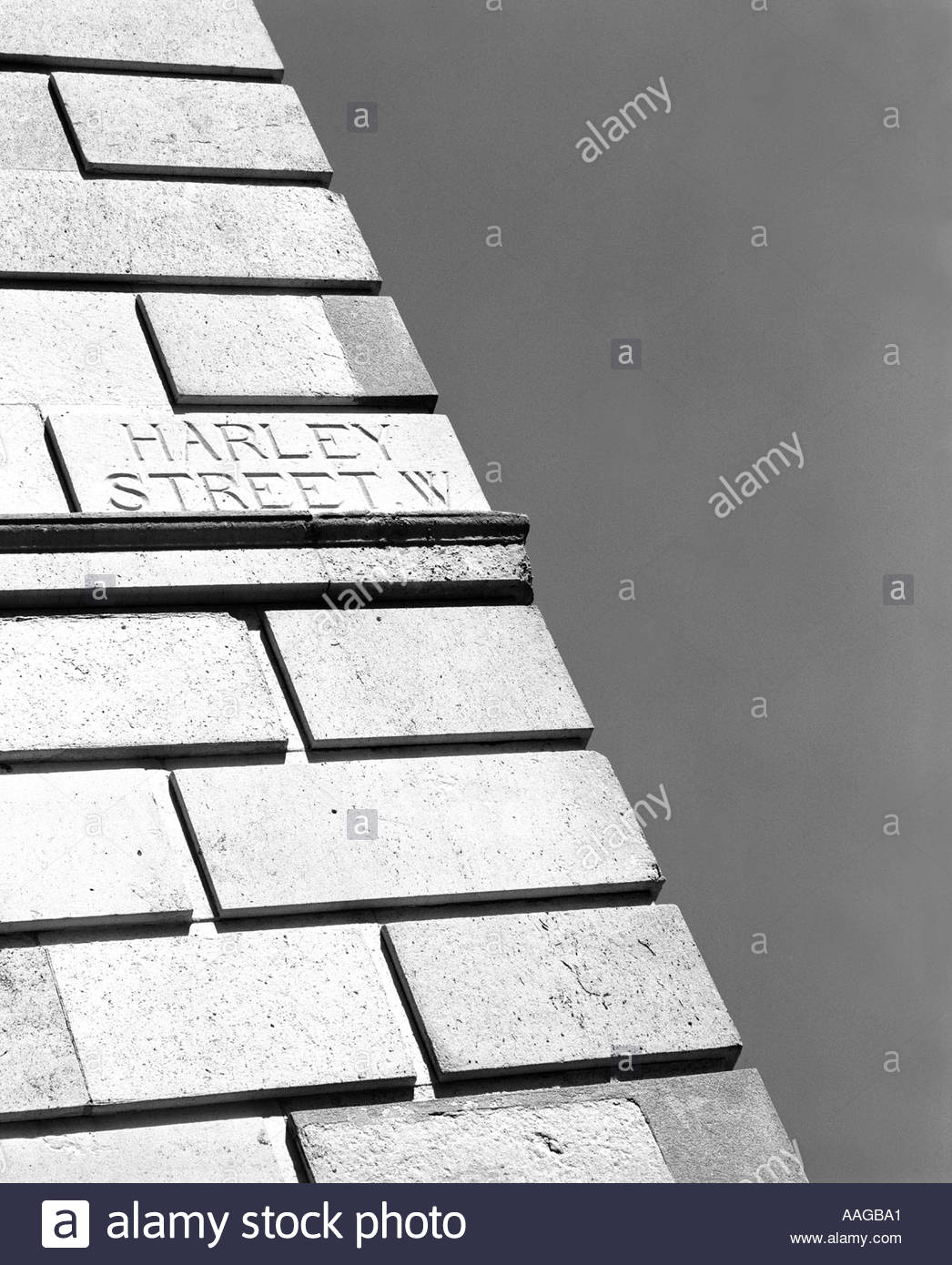 Harley street detail of street name carved in stone - Stock Image