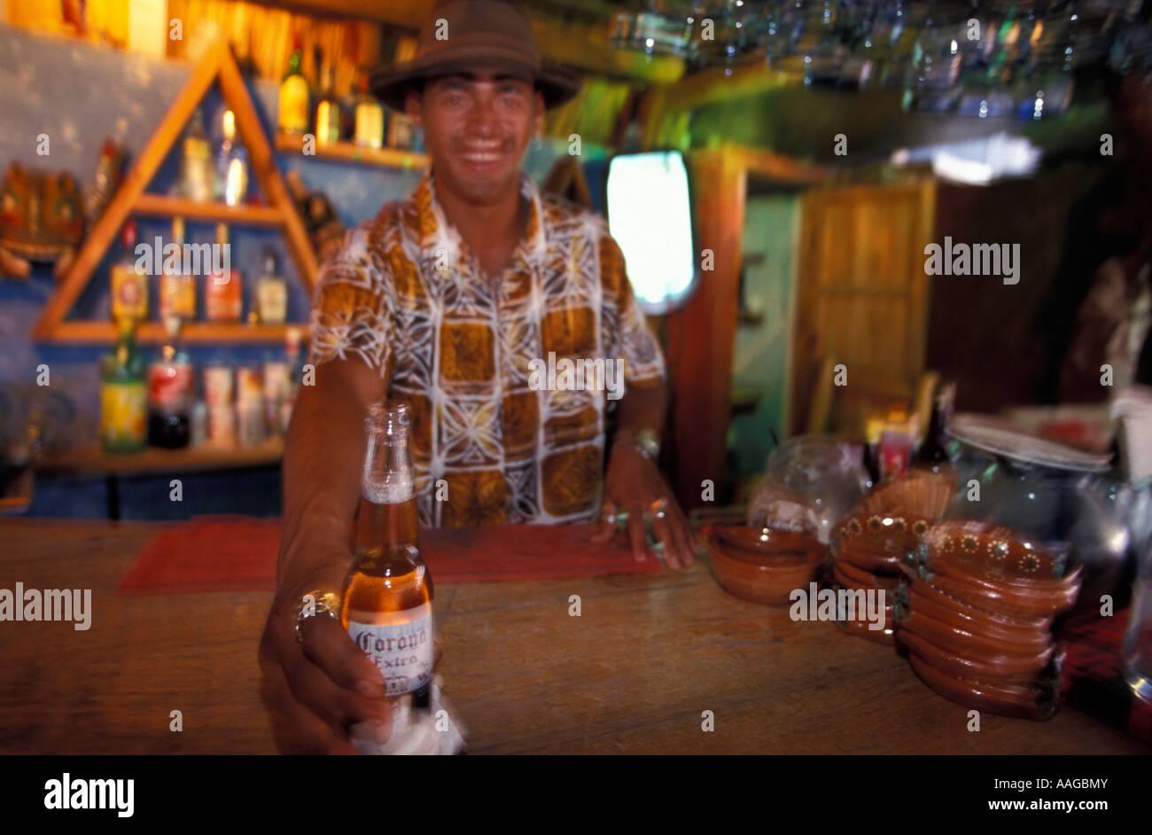 Barkeeper serving mexican beer Barra de Navidad Jalisco Mexico - Stock Image