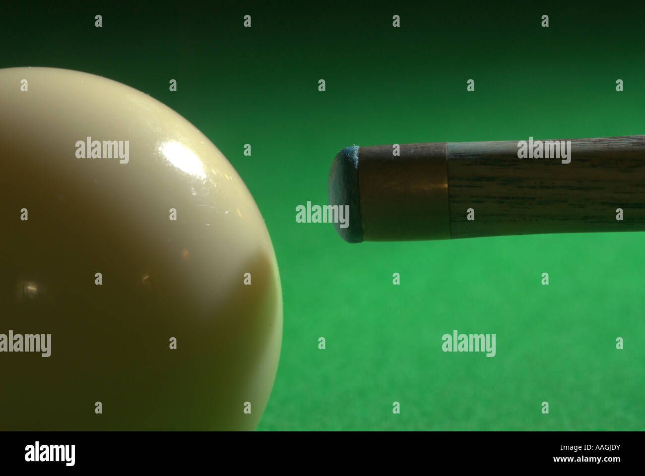 Cue ball and tip on the green baize of a snooker table UK - Stock Image