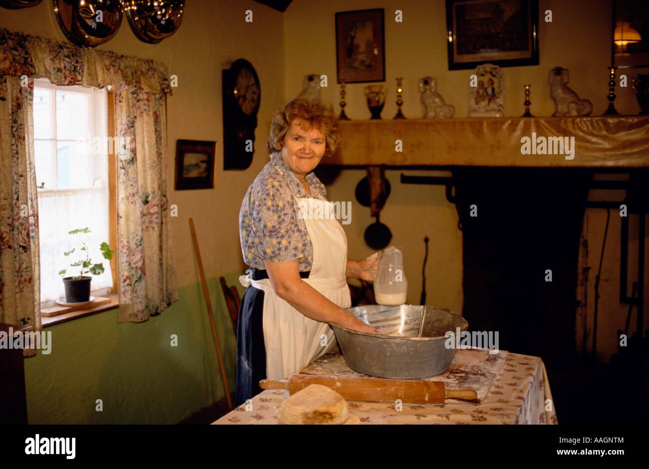 Women demonstrating traditional baking Bunratty Folk Park County Clare Ireland - Stock Image