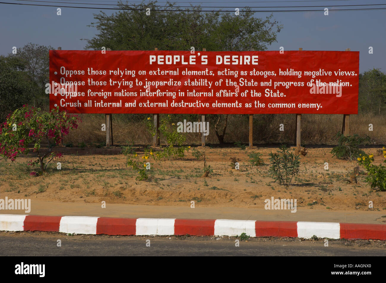 Myanmar Bagan street propaganda poster near the airport People s desire - Stock Image