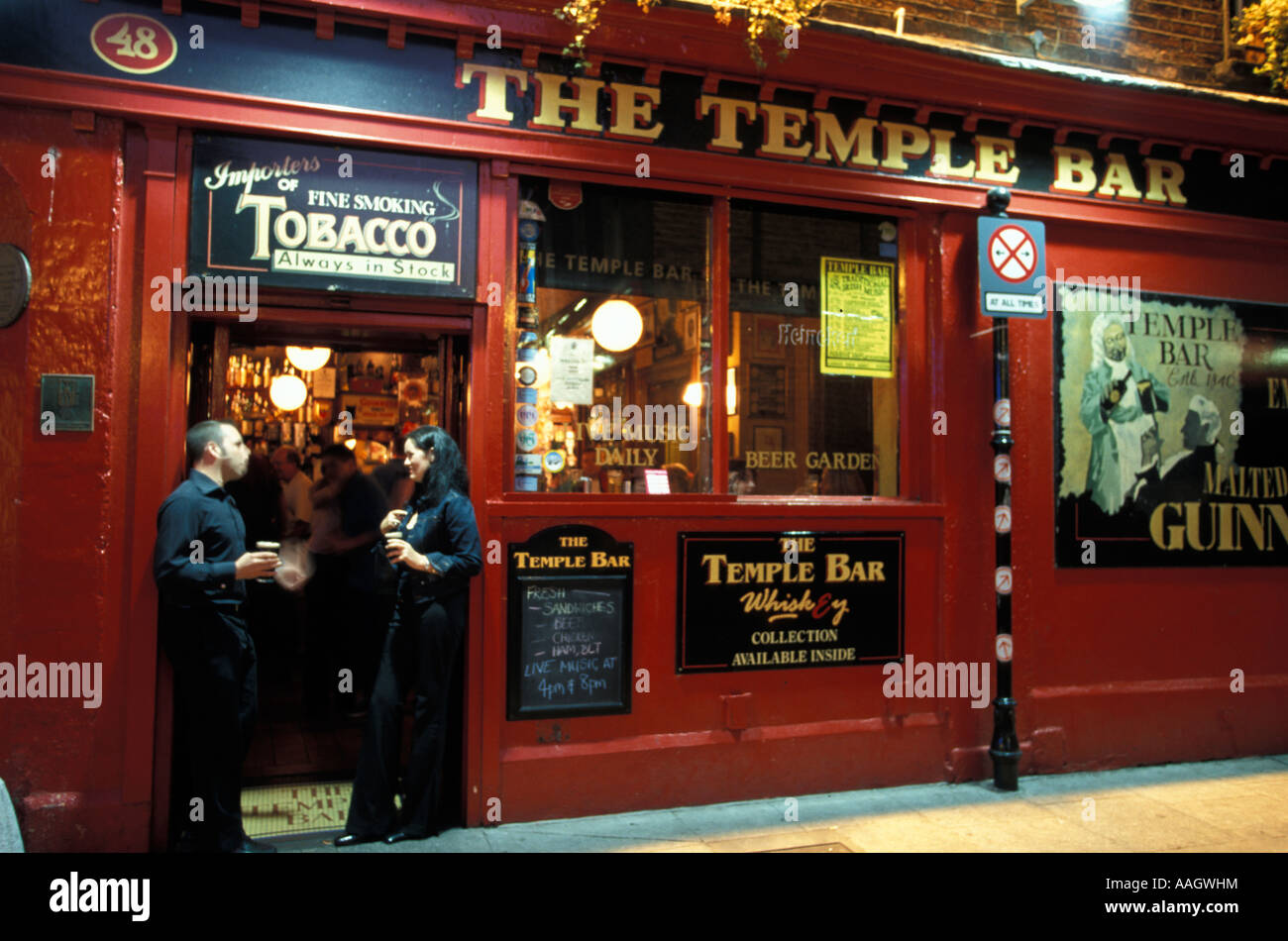 Couple standing at door of Temple Bar Pub Temple Bar district Dublin Dublin Ireland & Couple standing at door of Temple Bar Pub Temple Bar district Dublin ...