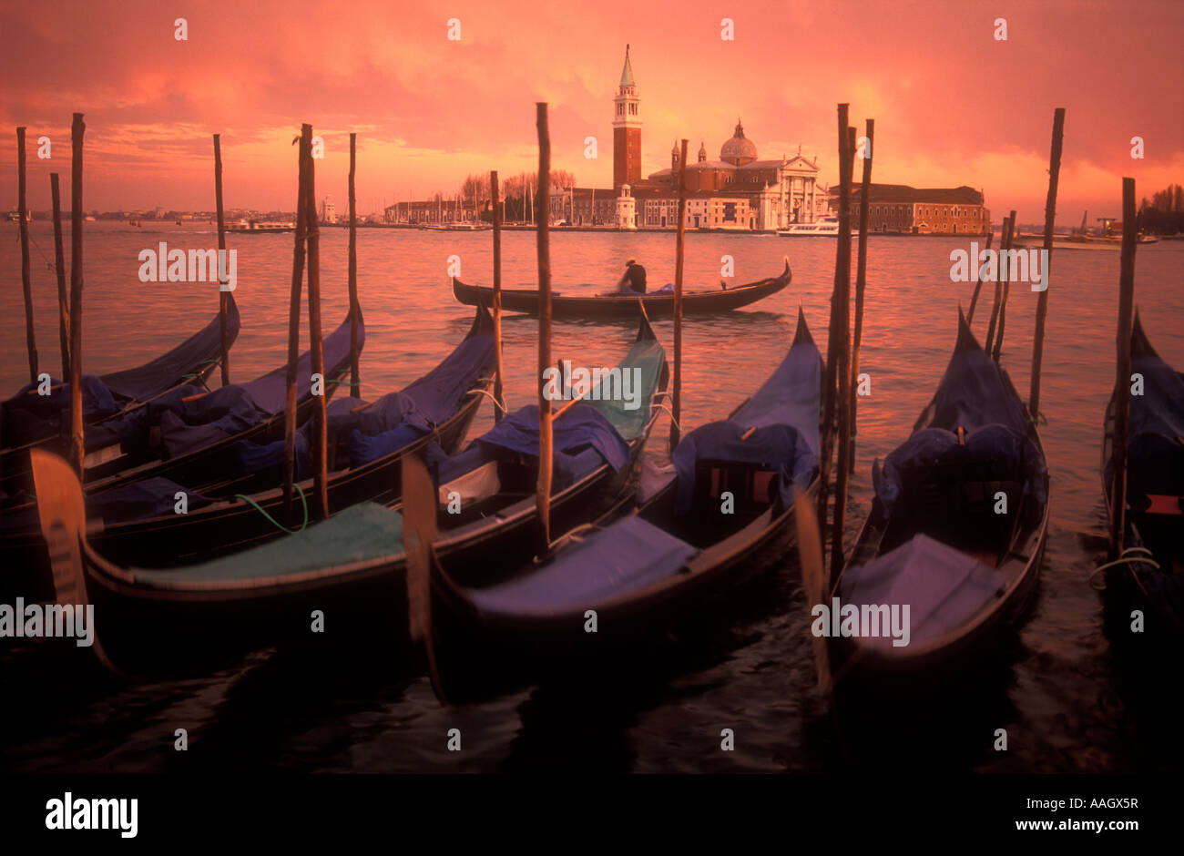Italy Venice gondolas moored with with view of San Giorgio Maggiore in background - Stock Image