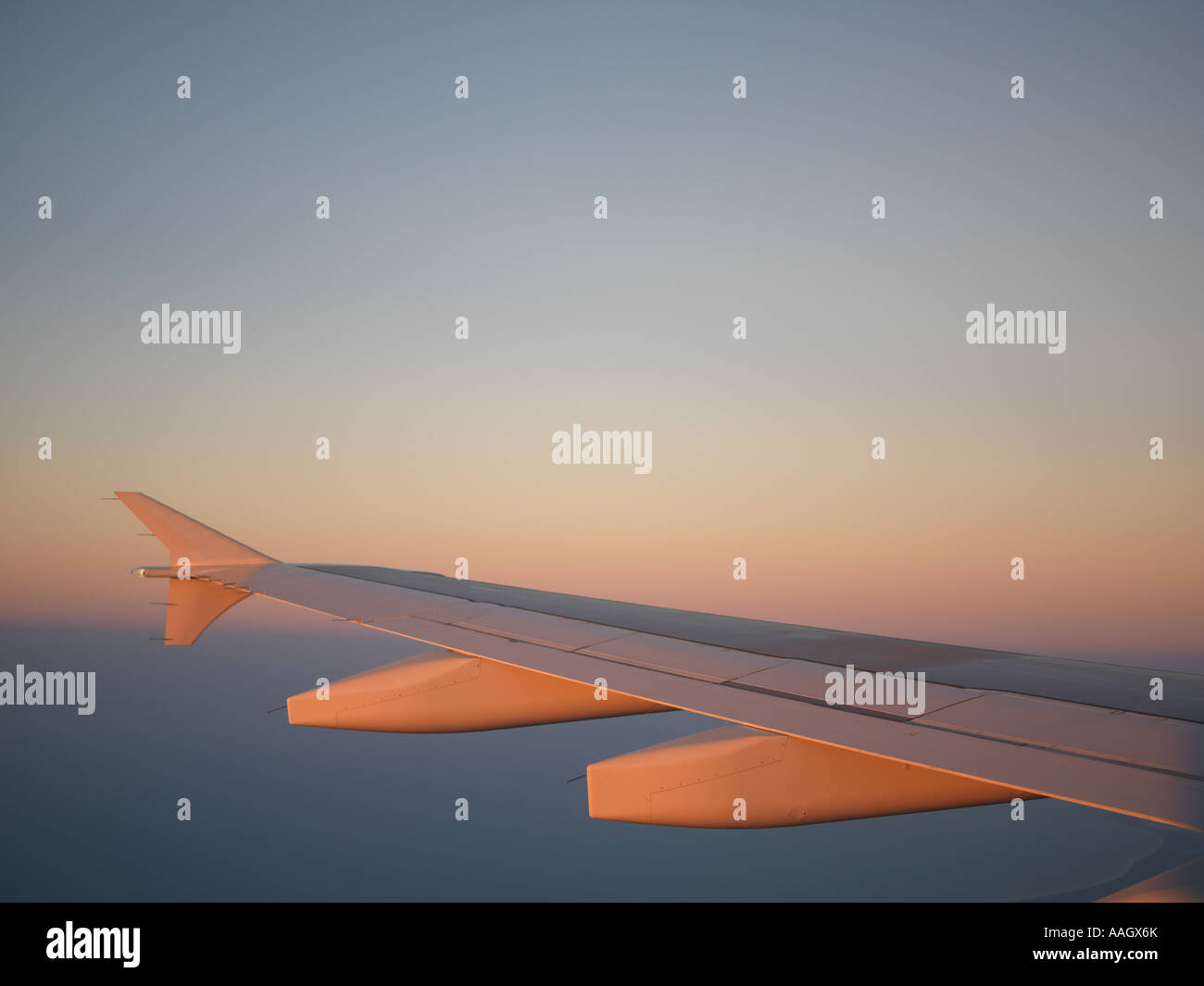 Mexico Cancun airplane wing at dusk - Stock Image