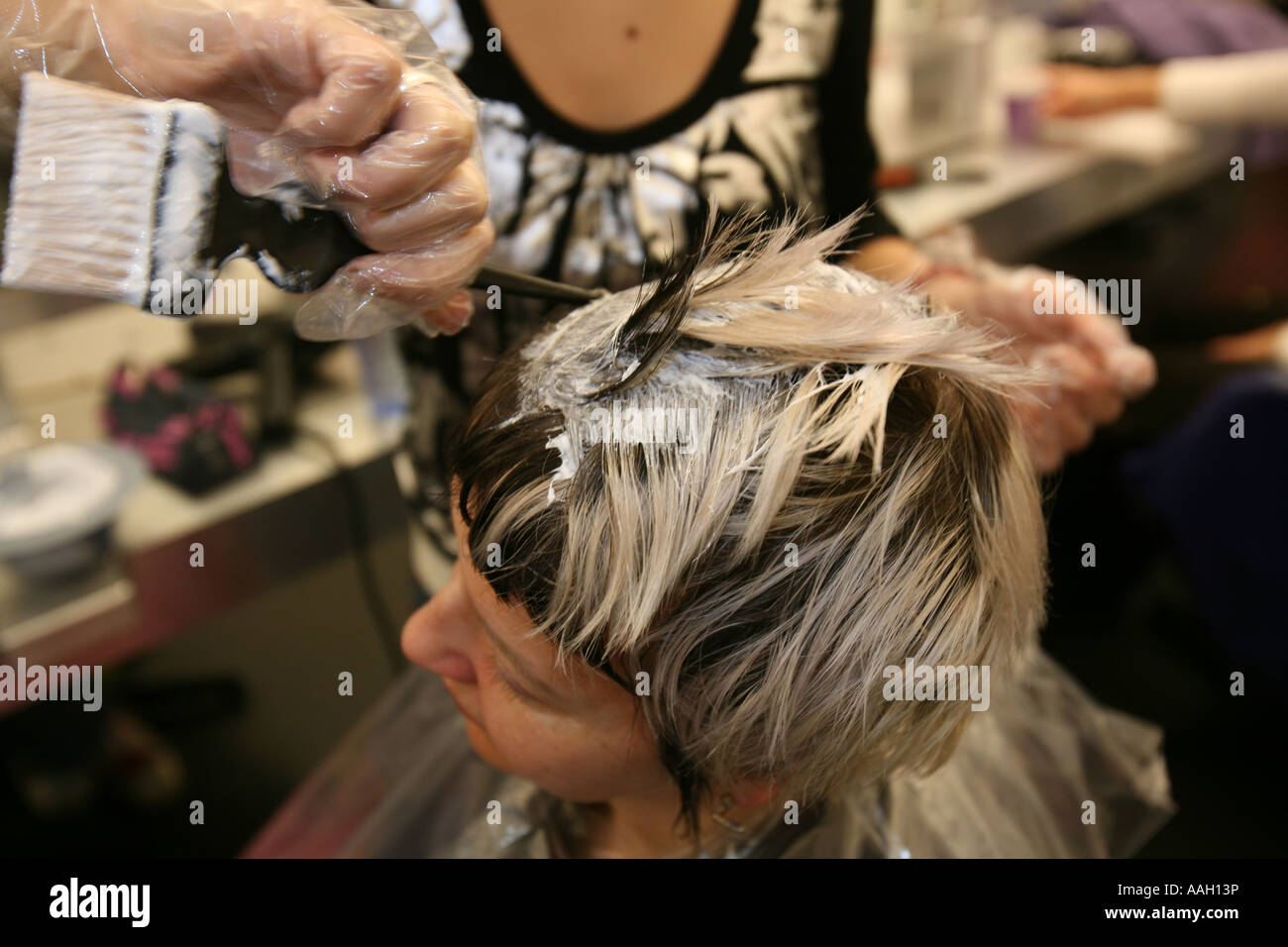 A kinki hairdresser gives a special touch to your hair compared to the common salons editorial use only no negative - Stock Image