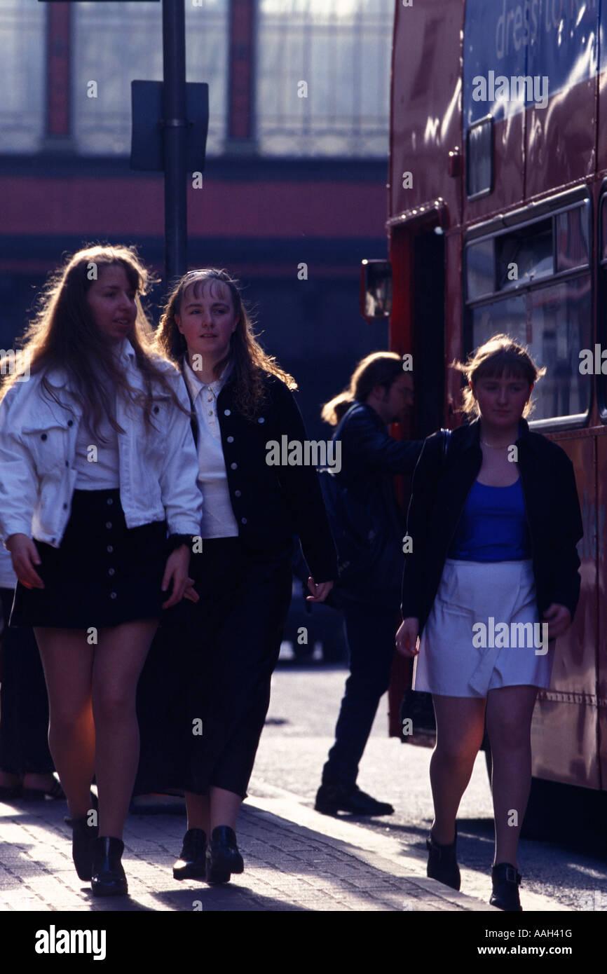 Women passing bus Glasgow Glasgow City Scotland United Kingdom Stock