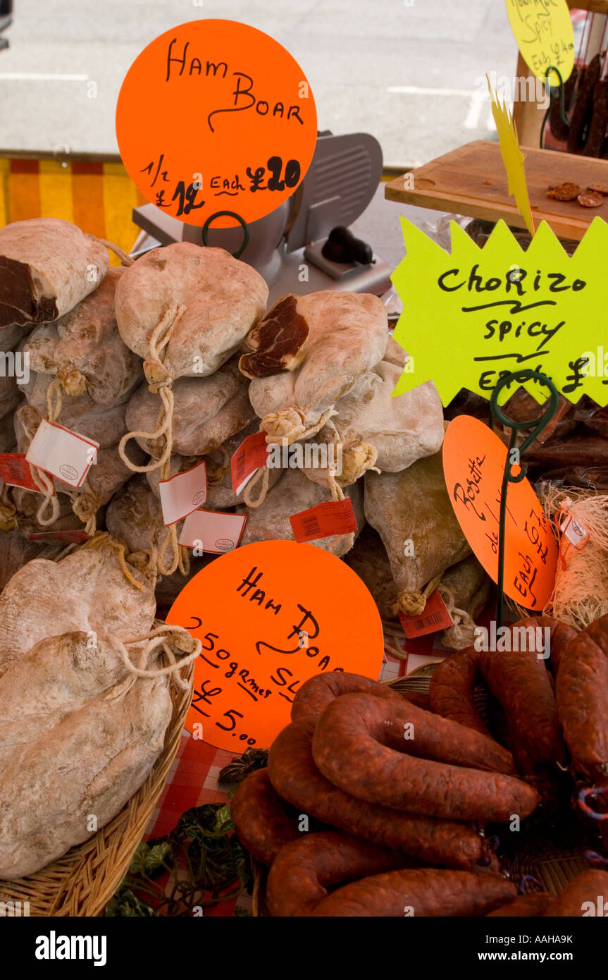 Various sausages salami and saucisson sec on sale on French market stall in Aberystwyth Wales with prices and labels - Stock Image