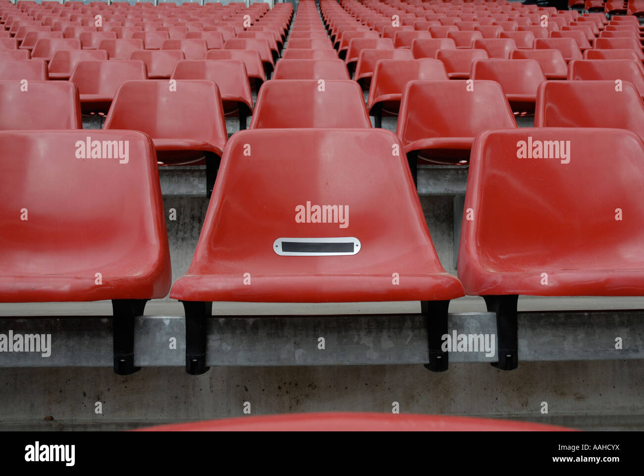 Empty red seats at the RheinEnergie Stadion, Cologne, Germany – Home of FC Koln. - Stock Image